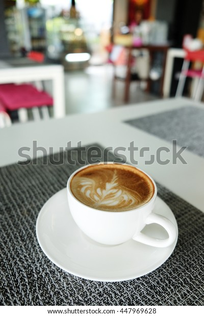Close up of hot coffee on white table and napkin concept.