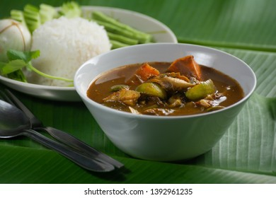 Close up of hot flavor  Southern Thailand soup And Cooked Rice with Various Vegetables of Asia on Green Banan Leaf.