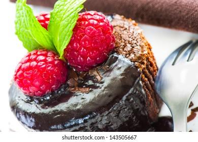 Close up of hot melting chocolate cake dessert with raspberry
