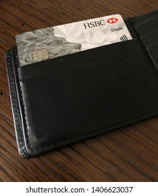 A close up of a HSBC credit card in a black wallet - image