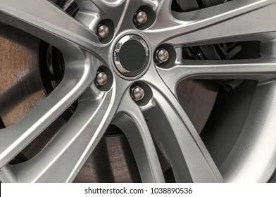 Photo of close up of a hub cap of a jaguar auto mobile