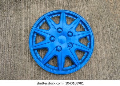 Close up of a hubcap isolated on concrete, selective focus.