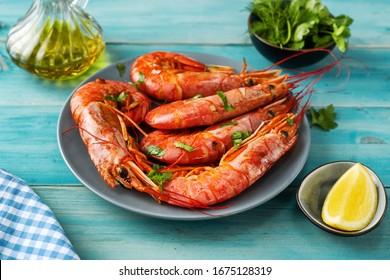 Close up of huge argentinian red prawns on aqua menthe background