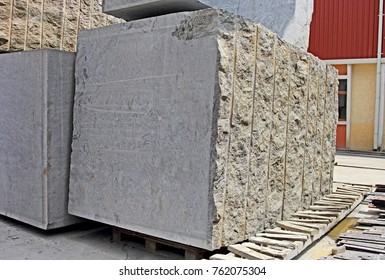 Close up of huge natural granite stone blocks ready for processing by cutting and polishing to make floor and wall slabs used in the construction of buildings.