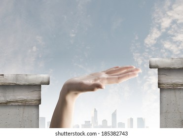 Close up of human hand between bridge gap