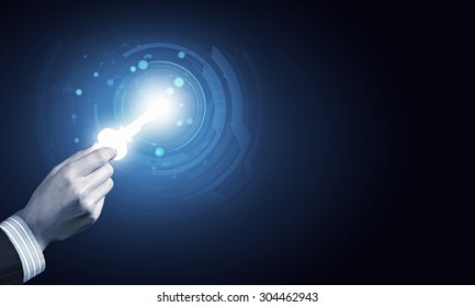 Close up of human hand with digital key icon