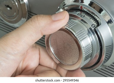 Close up human hand opened a safe, concept image suitable for security and secrecy.