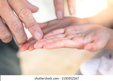 Close up human hand and psychic or fortune teller explains lines on palm. Palmistry concept
