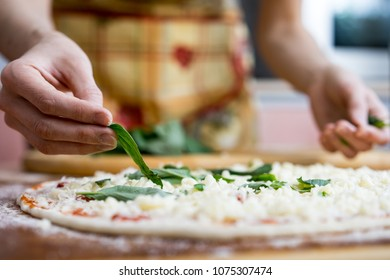 Close Up of human hands cooking vegetable salad in kitchen on the glass table with reflection. Healthy meal, and vegetarian food concept