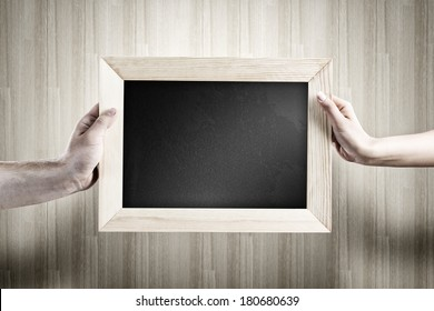 Close up of human hands holding blank frame