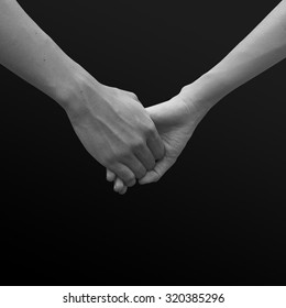 close up of human hands holding together for helping concept.