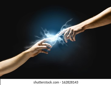 Close up of human hands touching with fingers