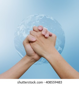 close up human handshake together on world on blur background.man hands shake for confident or success or victory or assurance concept:Elements of this image furnished by NASA