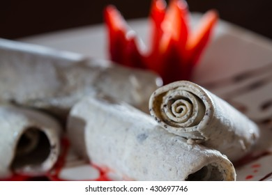 close up of an ice cream roll served at a restaurant garnished with a red strawberry