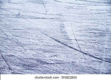 Close up of ice rink floor. Used as a textured background. Selective focus on lower-part of image. Defocus on upper.