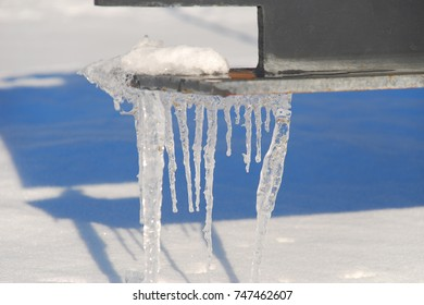 Close up of icicles with foreground and background blurred
