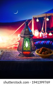 Close up of illuminated Egyptian lantern against traditional Arabic tent at the night. Beautiful evening in the desert during holy month of Ramadan.