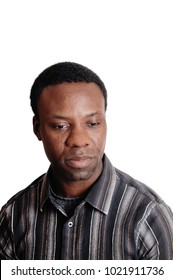 A close up image of an African American man in a striped shirt looing