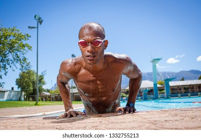 Close up image of an athletic male swimmer at a swimming pool