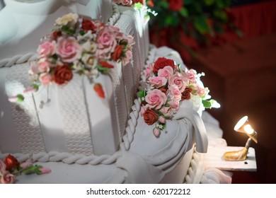 Close up image of a beautiful white wedding cake at wedding reception