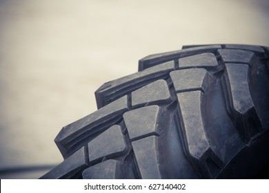 Close up image of a big truck tire.