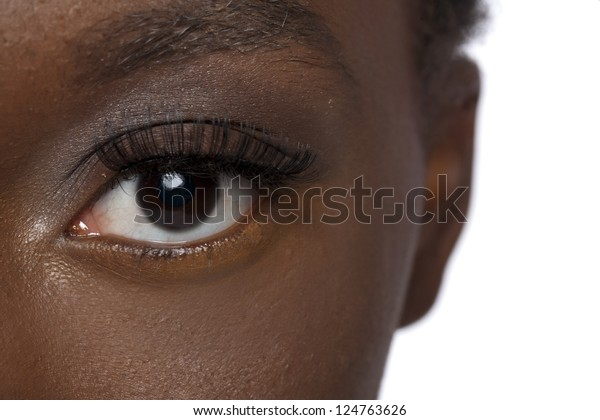 Close up image of black woman eye against white background