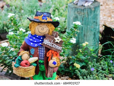 Close up image of a bright and cheerful garden scarecrow