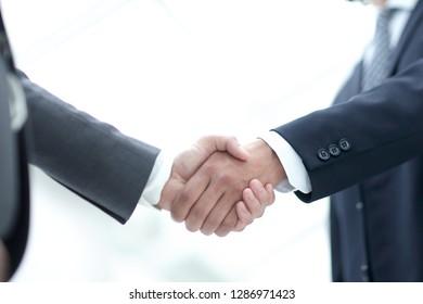 Close up image of business handshake at meeting.