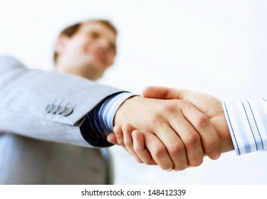 Close up image of business handshake at meeting. Partnership concept