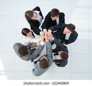 Close up image of business people making a stack of hands