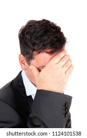 A close up image of a businessman in profile in a suit covering his face,