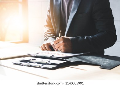 close up image of businessman at work table checking and Sign the permission the projects