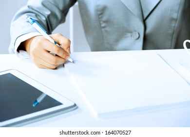 Close up image of businesswoman hands signing documents