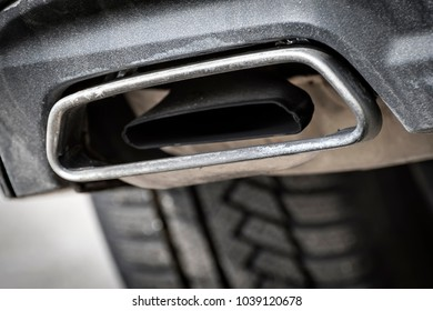 Close image of a car exhaust