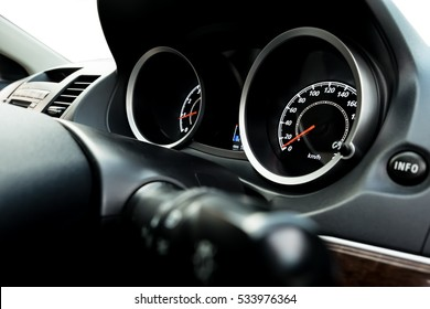 Close up image of car speed dashboard of car interior