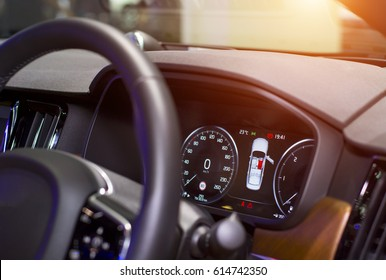 Close up image of car speed dashboard with light illuminated
