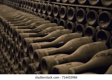 Close up image of champagne bottles in a wine rack while they ferment.