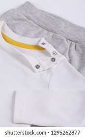 Close up image of children grey and white pyjamas set