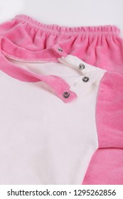 Close up image of children pink and white pyjamas set