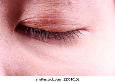 close up image of closed eyes