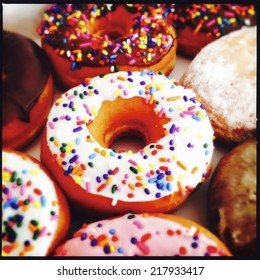 close up image of color donuts in a box