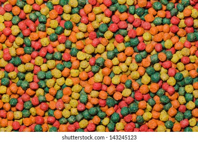 close up image of colorful fish food pellets