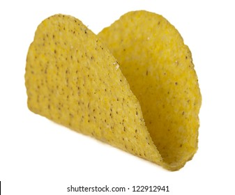Close up image of crunchy taco shell against white background