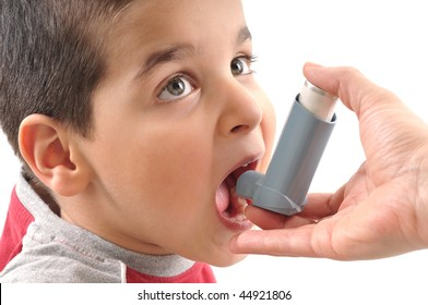 Close up image of a cute little boy ready to use inhaler for asthma from his mothers hand. White background studio picture.