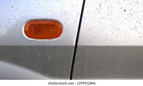 Close up image of a dirty car