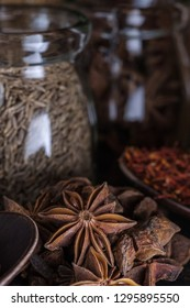Close up image of dried star anise and various spices on wooden table. Selective focus.