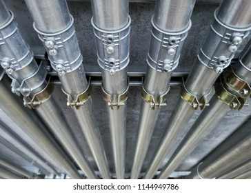 A close up image of electrical metallic tubing in the building.