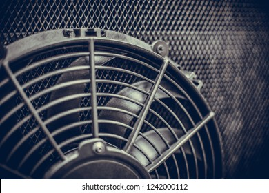 Close up image of the engine cooling fan of a bus.