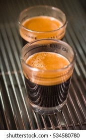 Close up image of espresso coffee in glass shot