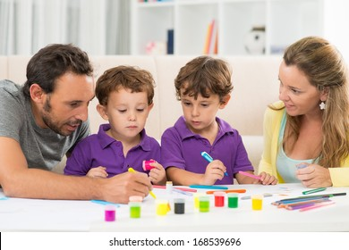 Close up image of a family painting together at home